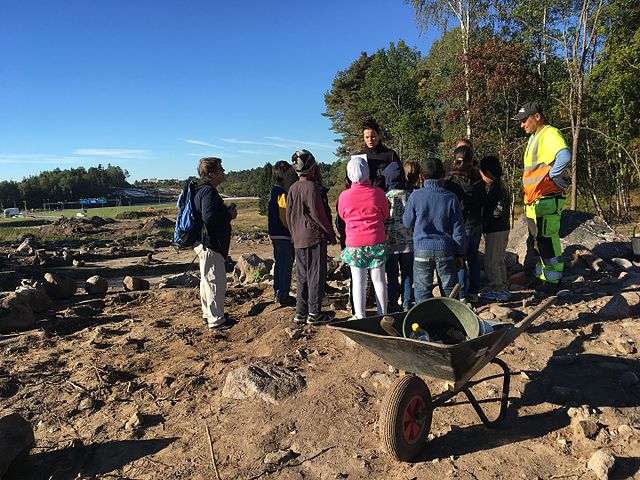 Young students visiting a nearby excavation site in Stockholm, Sweden.