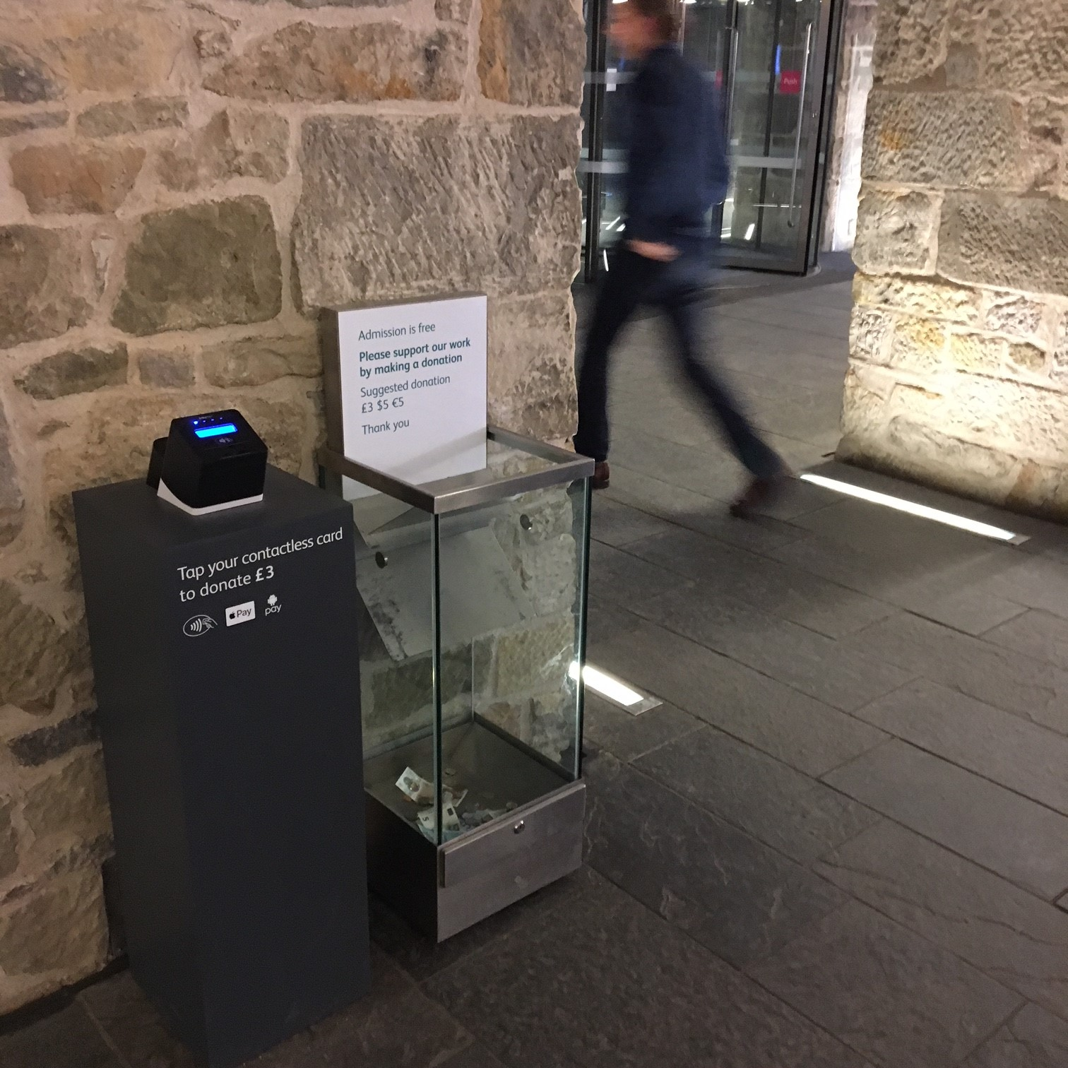 The contactless donation terminal close to the main entrance to the National Museum of Scotland