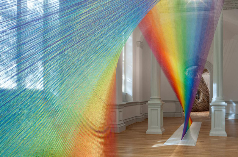 interior of Renwick Gallery during WONDER exhibition, showing rainbow colored strands of thread that form Plexus A1, by Gabriel Dawe