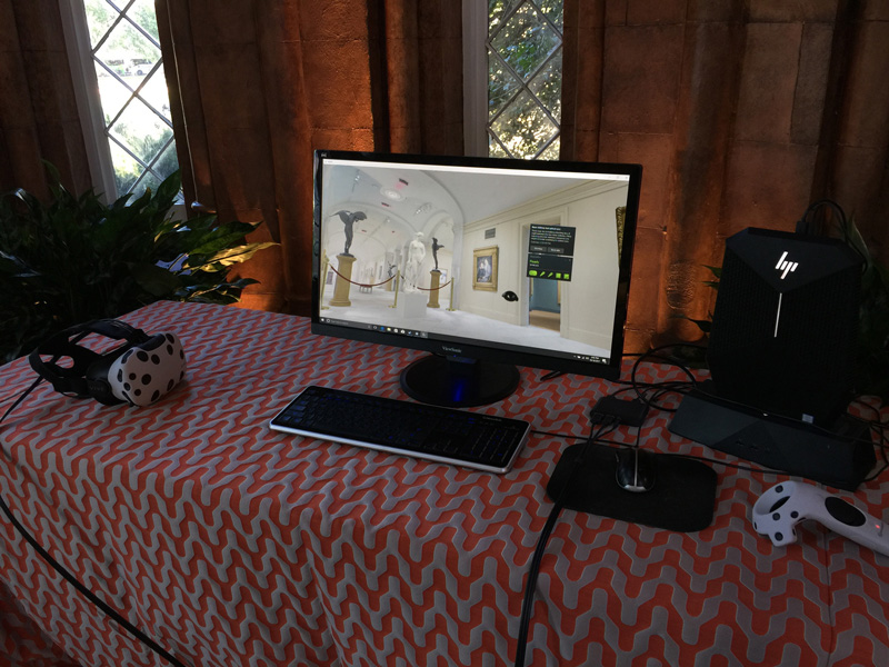 Table holding computer, monitor and HTC Vive headset and controller